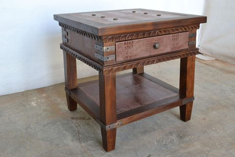 Leather inlay detail on top table