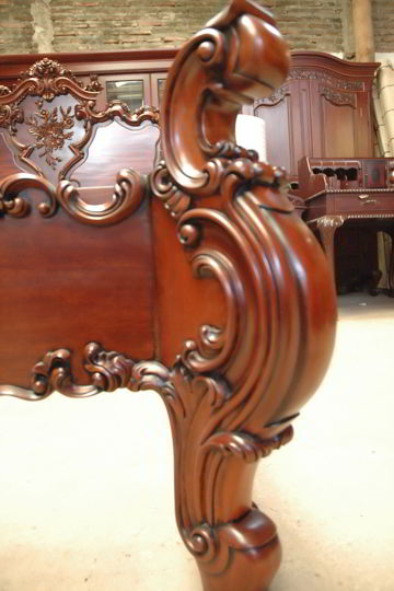 Carving ornament at the headboard bottom frame