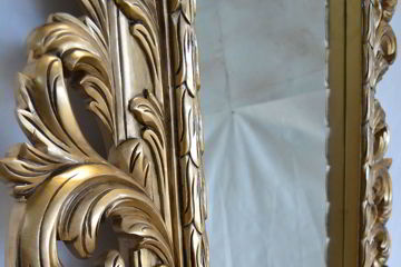 Acanthus carving detail at the left frame