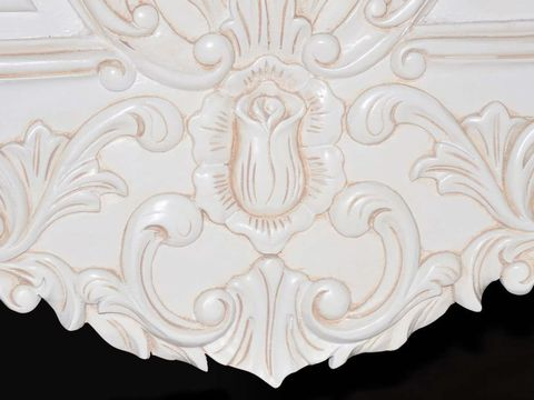 Beautiful elaborate carving on the bottom of the footboard.