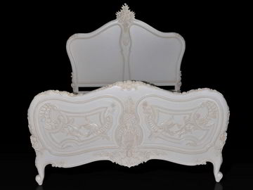 Rococo bed front view, the indentations on top and carving details of the foot board are shown.