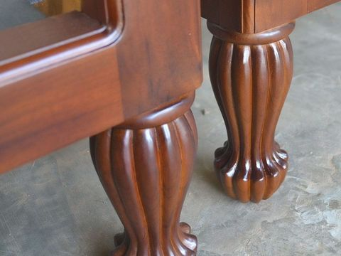Front view of the teak tub chair, solid wood side frames profiled at the left and right.
