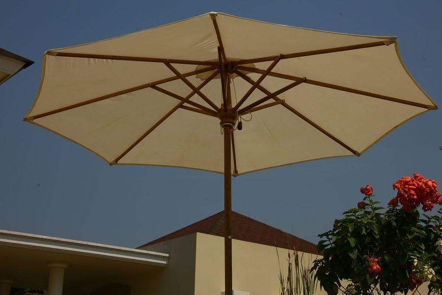 Teak and sunbrella parasols